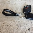 Loop key fob in Black with Silver imprint.
