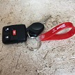 Loop key fob in Red with White Imprint.