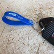 Loop Key Fob in Blue with White Imprint.