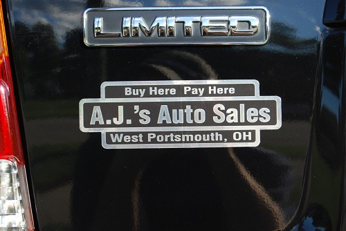 Bright Chrome Polyester Dealer Decal #781 shown in Chrome background and Black Reverse Printing. (Printed so the background looks black and letters look chrome).