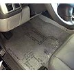 Protective Self Adhesive Plastic Floor Mats shown in place in vehicle.
